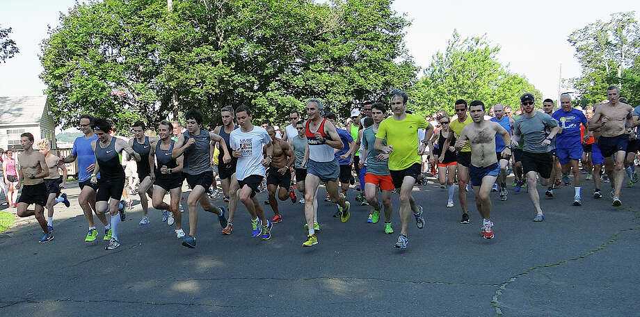 Nearly 300 runners turned out in Saturday morning's high heat and humidity for the Westport Road Runners' 5K race at Longshore Park. Photo: Mike Lauterborn / Westport News contributed