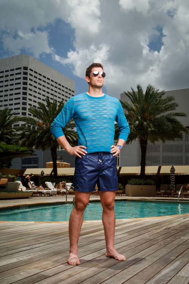 Houston Dynamo goalkeeper Tally Hall wears a blue sweater by Salvatore Ferragamo, $670, 2XIST navy trunks, $138, silver Ray Ban sunglasses, $185, and Prada flip-flops, all from Saks Fifth Avenue.  Stylist: Leslie Rivas-Kelly  Grooming: Bianca Linette  Location: Four Seasons Hotel Houston  Stylist's assistant: Tanesha Seafous