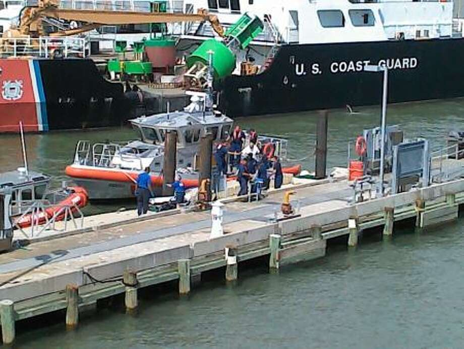 Coast Guard crew members rescued a woman who had hurt her back while on a pleasure boat 15 miles off Galveston. Photo: U.S. Coast  Guard