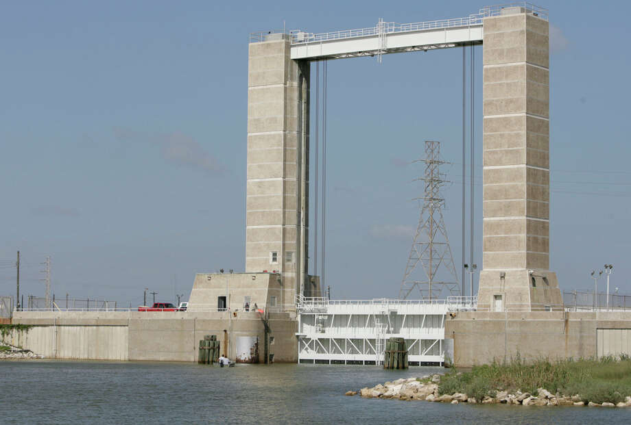 A tide gate along the Brazos River is seen after it was lowered by crews on Thursday, Sept. 11, 2008, in Freeport in preparation for the incoming Hurricane Ike threat. The gate will keep the rising waters away from entering the river. ( Julio Cortez / Chronicle ) Photo: Julio Cortez, Staff / Houston Chronicle