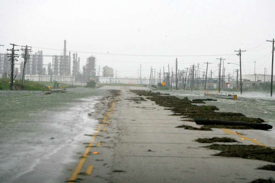 Texas City refineries experienced flooding from the storm surge as Hurricane Ike approached Galveston Island in 2008. The storm caused $37.5 billion in damages. Photo: Bill Olive, Freelance / Freelance