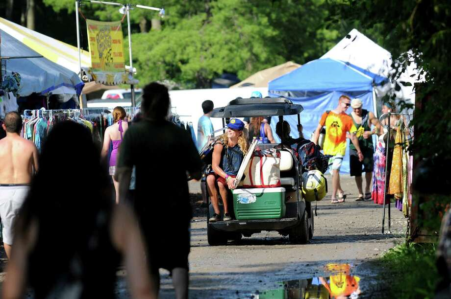 Phish music fans hitch a ride through the vendors camps to their own campsite on Friday, July 5, 2013, at Lee's Park Campground in the Town of Saratoga, N.Y. Phish plays three show at Saratoga Performing Arts Center. (Cindy Schultz / Times Union) Photo: Cindy Schultz / 00023077A
