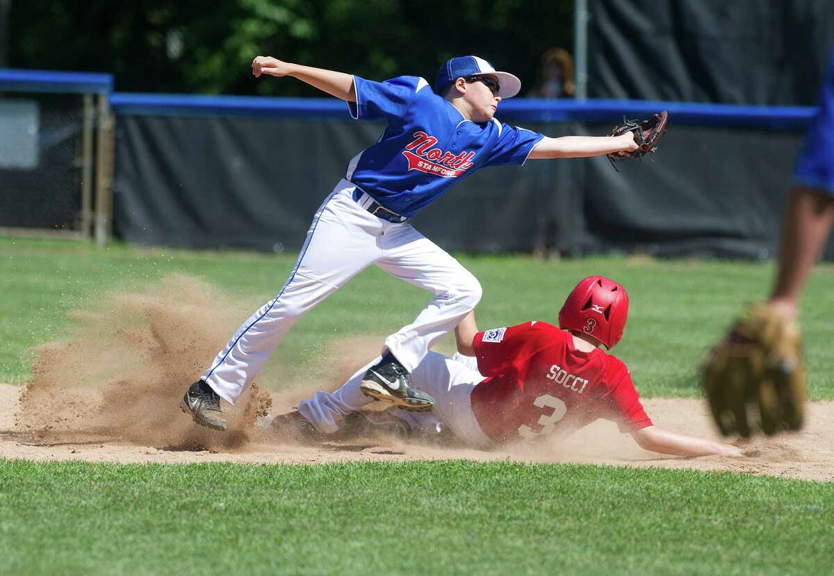 Stamford American's Leo Socci is safe at second base as North Stamford's Noah Skaug reaches for the ball on the double play attempt during Saturday's Little League quarterfinal game at Chestnut Hill Park in Stamford, Conn., on July 6, 2013.