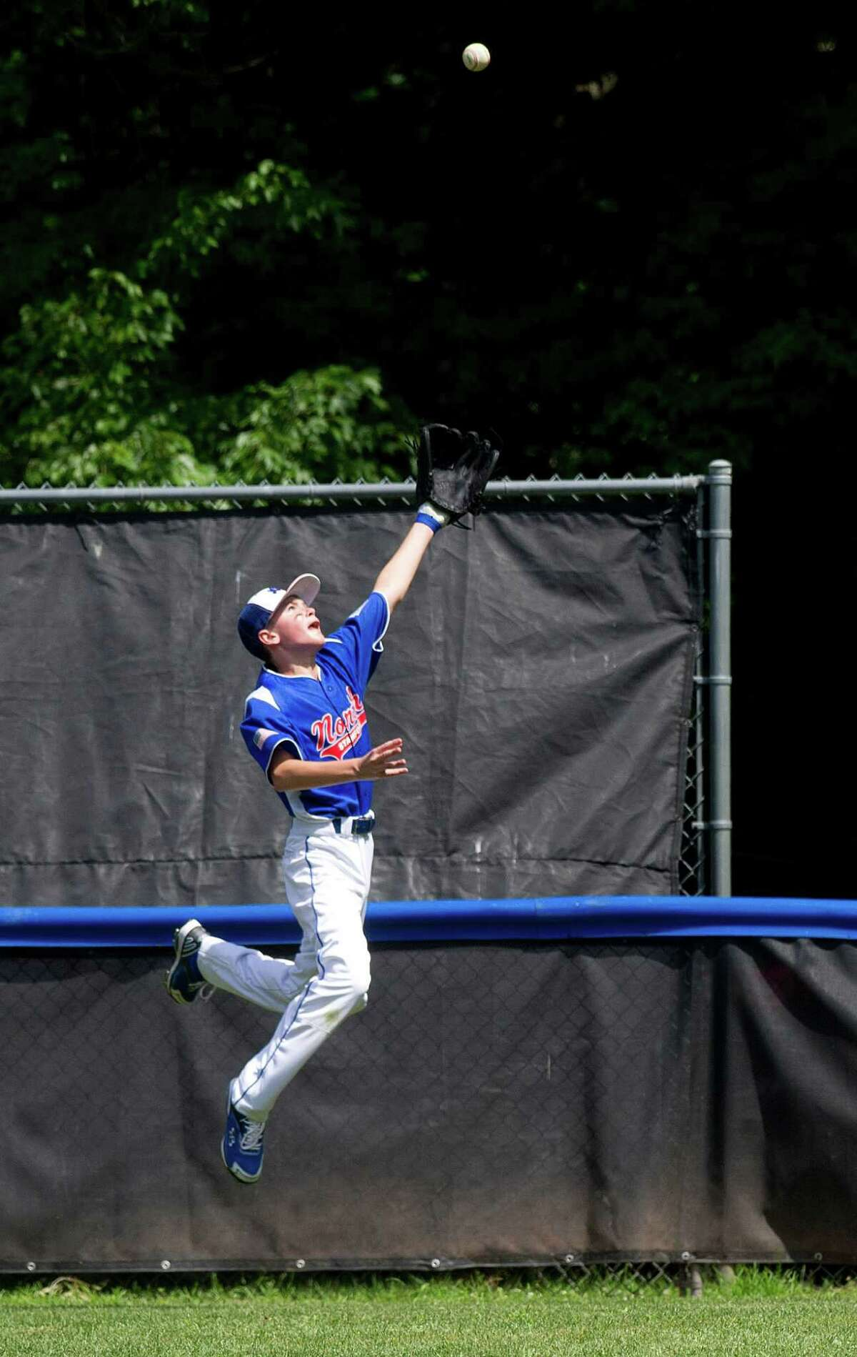 North Stamford's Bobby Zsmarslak jumps for the ball during Saturday's Little League quarterfinal game at Chestnut Hill Park in Stamford, Conn., on July 6, 2013.