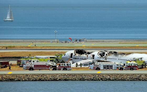 Asiana Airlines flight 214 is shown on the runway at San Francisco International Airport after crash landing on July 6, 2013. Photo: Josh Edelson, AFP/Getty Images