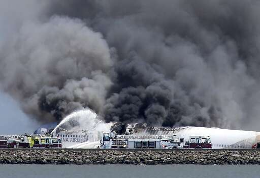 Fire crews work the crash site of Asiana Flight 214 at San Francisco International Airport in San Francisco, Saturday, July 6, 2013. (AP Photo/Bay Area News Group, John Green) Photo: John Green, Associated Press