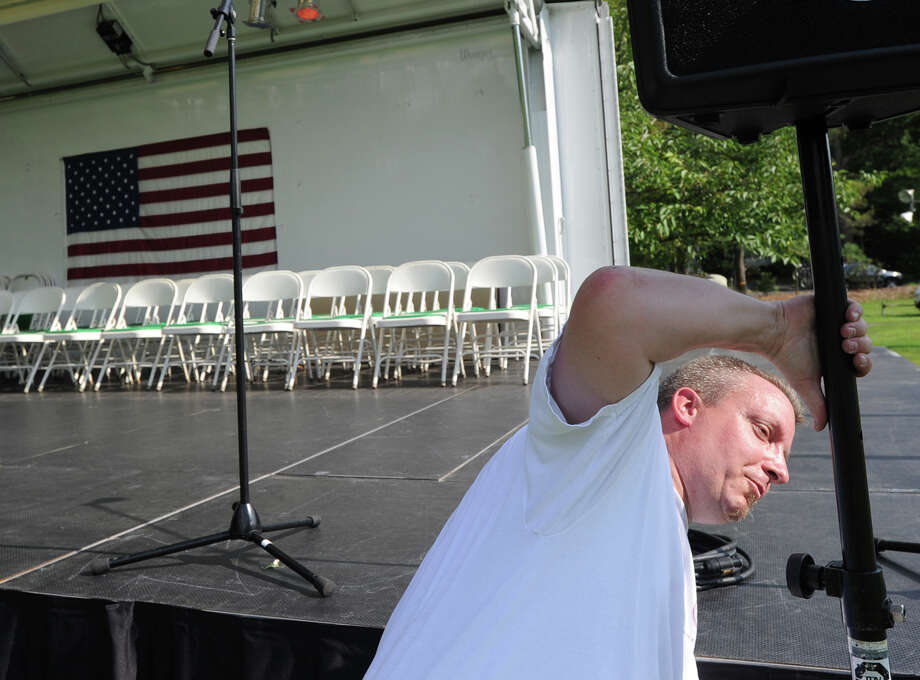 Greenwich resident of Matt Dolan, owner of the Ambassador Event Production Compnay, sets up the sound system prior to the Town of Greenwich fireworks show at Binney Park in Old Greenwich, Saturday, July 6, 2013. Photo: Bob Luckey / Greenwich Time