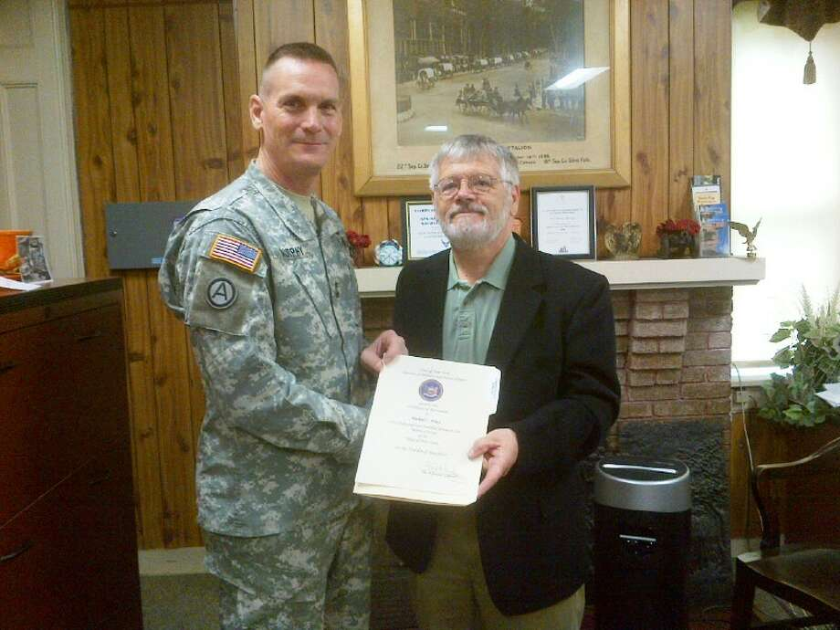 Division of Military and Naval Affairs Michael Aikey, the manager of the New York State Military Museum and Veterans Research Center, holds his retirement certificate following his retirement luncheon. Major Gen. Patrick Murphy presented the certificate.