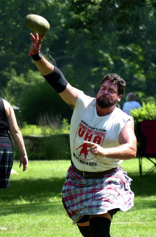 Shane Southerland, of Goose Creek, SC, takes part in the open stone event, during the 90th Annual Round Hill Highlander Games at Cranbury Park in Norwalk, Conn. on Saturday July 6, 2013. Photo: Christian Abraham / Connecticut Post