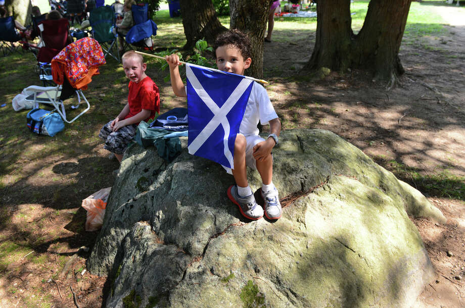 David Anderson, 5, of Bethel, proudly holds a flag of Scotland, during the 90th Annual Round Hill Highlander Games at Cranbury Park in Norwalk, Conn. on Saturday July 6, 2013. Photo: Christian Abraham / Connecticut Post