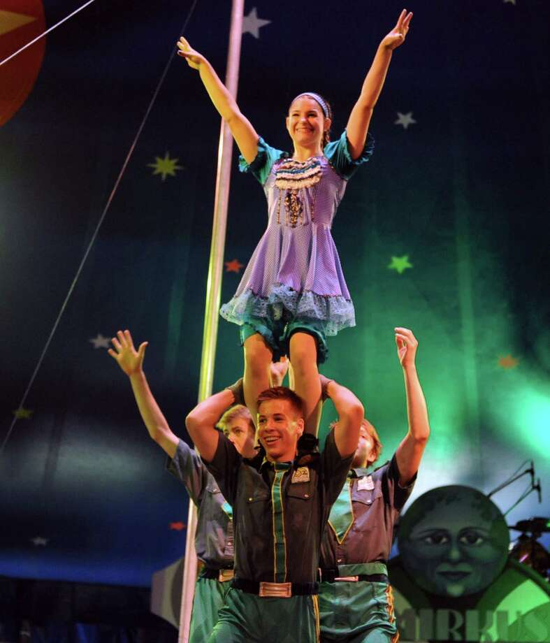 Keenan Wright-Sanson of Saratoga Springs balances Alyson Mattei, playing Dorothy, on his shoulders as Circus Smirkus, the acclaimed international youth circus, performs a Wizard of Oz themed show at the Saratoga Race Course presented by The Waldorf School on Saturday July 6, 2013 in Saratoga Springs, N.Y. (Michael P. Farrell/Times Union) Photo: Michael P. Farrell / 00023050A