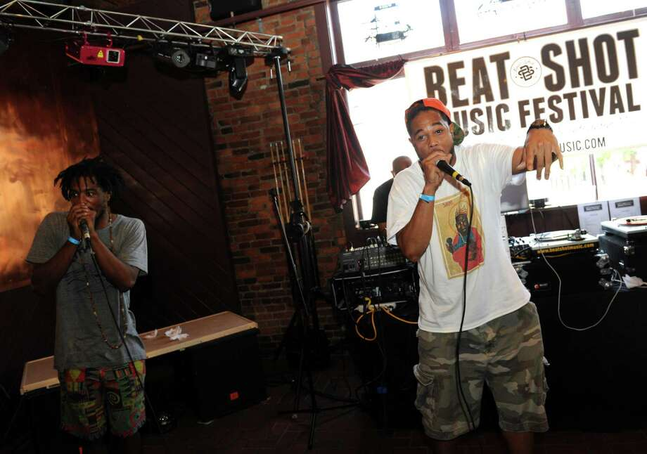 Rhyson Hall, left, and Grand phee perform during the 5th Annual Beatshot Music Festival, a celebration of hip hop, art and independent music, at Red Square on Saturday July 6, 2013 in Albany, N.Y. (Michael P. Farrell/Times Union) Photo: Michael P. Farrell / 00023080A