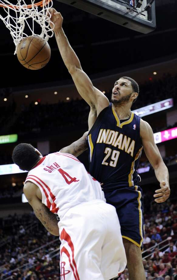 Indiana Pacers' Jeff Pendergraph (29) dunks the ball over Houston Rockets' Greg Smith (4) in the second half of an NBA basketball game, Wednesday, March 27, 2013, in Houston. The Pacers won 100-91. (Pat Sullivan / Associated Press)