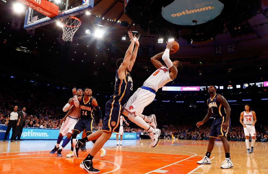 J.R. Smith #8 of the New York Knicks in action against Jeff Pendergraph #29 of the Indiana Pacers at Madison Square Garden on April 14, 2013 in New York City. The Knicks defeated the Pacers 90-80. (Jim McIsaac / Getty Images)