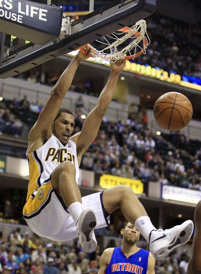 Indiana Pacers' Jeff Pendergrap dunks during the second half of an NBA basketball game against the Detroit Pistons Monday, April 23, 2012, in Indianapolis. Indiana defeated Detroit 103-97. (Darron Cummings / Associated Press)