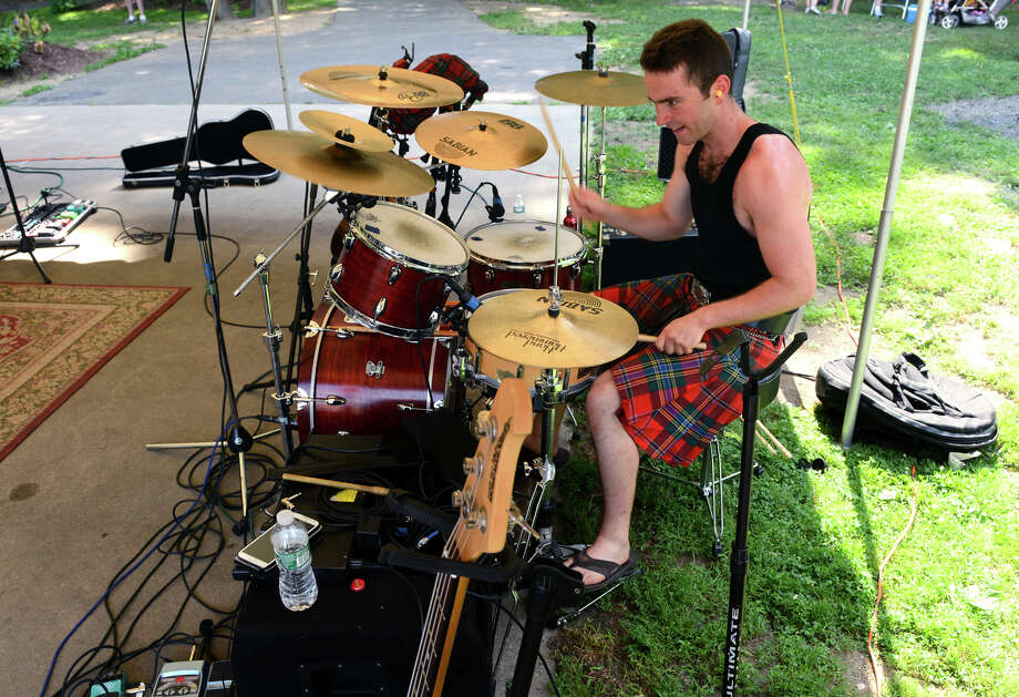 Jesse Ofgang, of the band MacTalla Mor, out of Danbury, performs during the 90th Annual Round Hill Highlander Games at Cranbury Park in Norwalk, Conn. on Saturday July 6, 2013. Photo: Christian Abraham / Connecticut Post