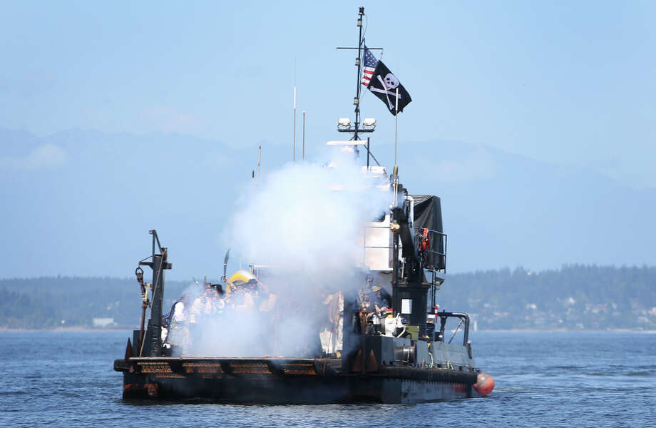 The Seafair Pirates fire a cannon from their boat in Elliott Bay. Photo: JOSHUA TRUJILLO, SEATTLEPI.COM