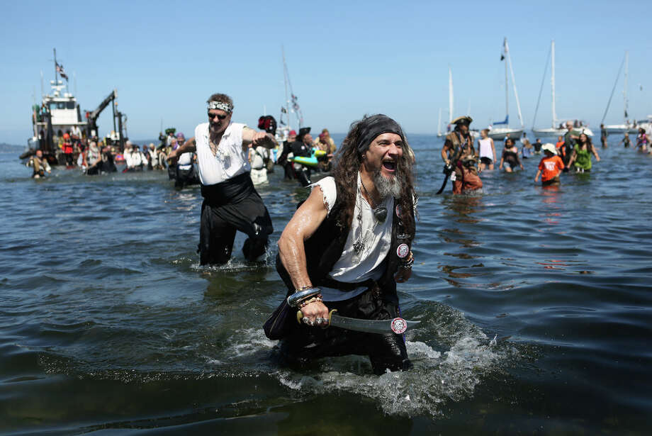 Seafair Pirates march onto shore. Photo: JOSHUA TRUJILLO, SEATTLEPI.COM