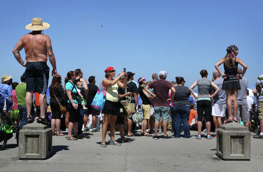 People watch the action from shore. Photo: JOSHUA TRUJILLO, SEATTLEPI.COM