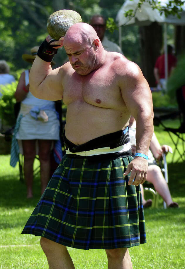 Lou Santelli, of Shelton, gets ready to take part in the open stone event, during the 90th Annual Round Hill Highlander Games at Cranbury Park in Norwalk, Conn. on Saturday July 6, 2013. Photo: Christian Abraham / Connecticut Post