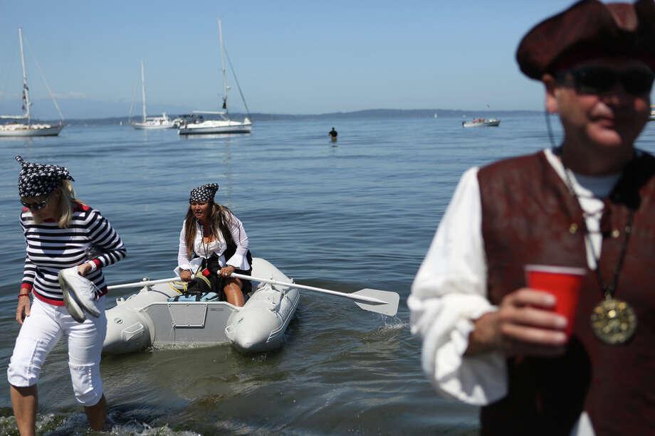 Pirates gather on shore during the Seafair Pirates Landing. Photo: JOSHUA TRUJILLO, SEATTLEPI.COM