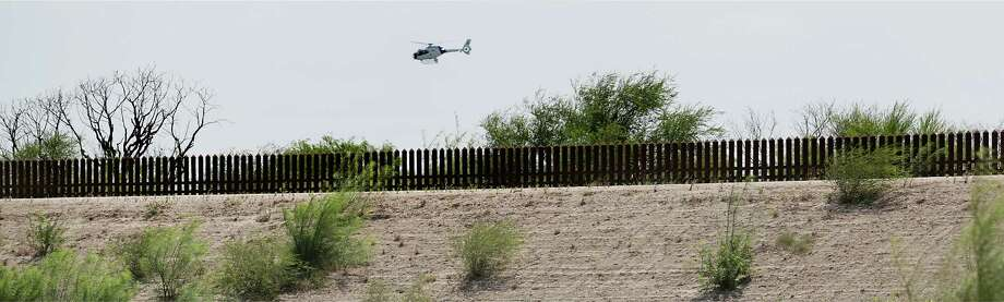 A U.S. Customs and Border Protection helicopter patrols the border along the wall near the Hidalgo Bridge in the Rio Grande Valley, on Thursday June 27, 2013. Photo: Bob Owen, San Antonio Express-News / © 2012 San Antonio Express-News