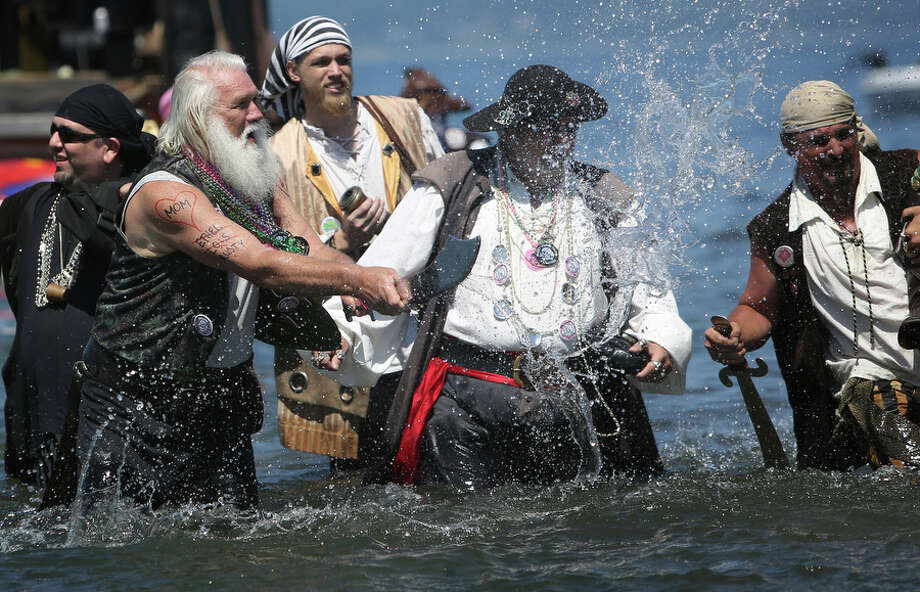 A pirate splashes water during the Seafair Pirates Landing. Photo: JOSHUA TRUJILLO, SEATTLEPI.COM