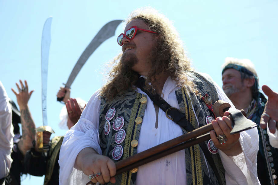 A pirate wears heart-shaped sunglasses. Photo: JOSHUA TRUJILLO, SEATTLEPI.COM
