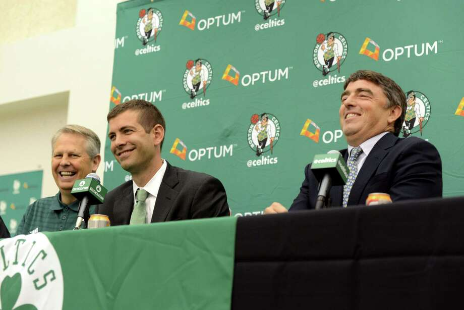 WALTHAM, MA - JULY 5: New Boston Celtics head coach Brad Stevens (C) is introduced to the media by President of Basketball Operations Danny Ainge (L) and Team Owner Wyc Grousbeck July 5, 2013 in Waltham, Massachusetts. Stevens was hired away from Butler University where he led the Bulldogs to two back to back national championship game appearances in 2010, and 2011. Photo: Darren McCollester, Getty Images / 2013 Getty Images