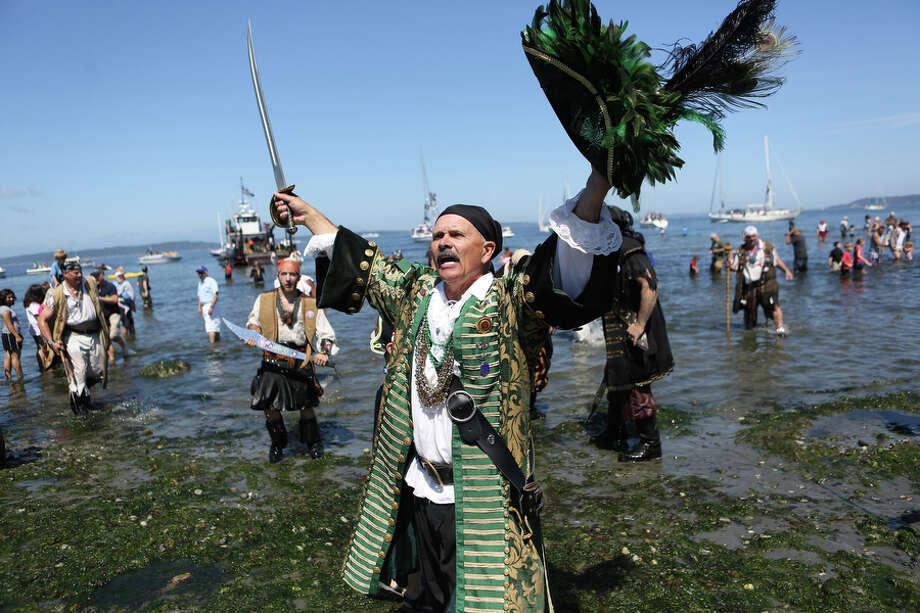Davey Jones, aka Jay Albrecht, lands on the beach during the Seafair Pirates Landing. Photo: JOSHUA TRUJILLO, SEATTLEPI.COM