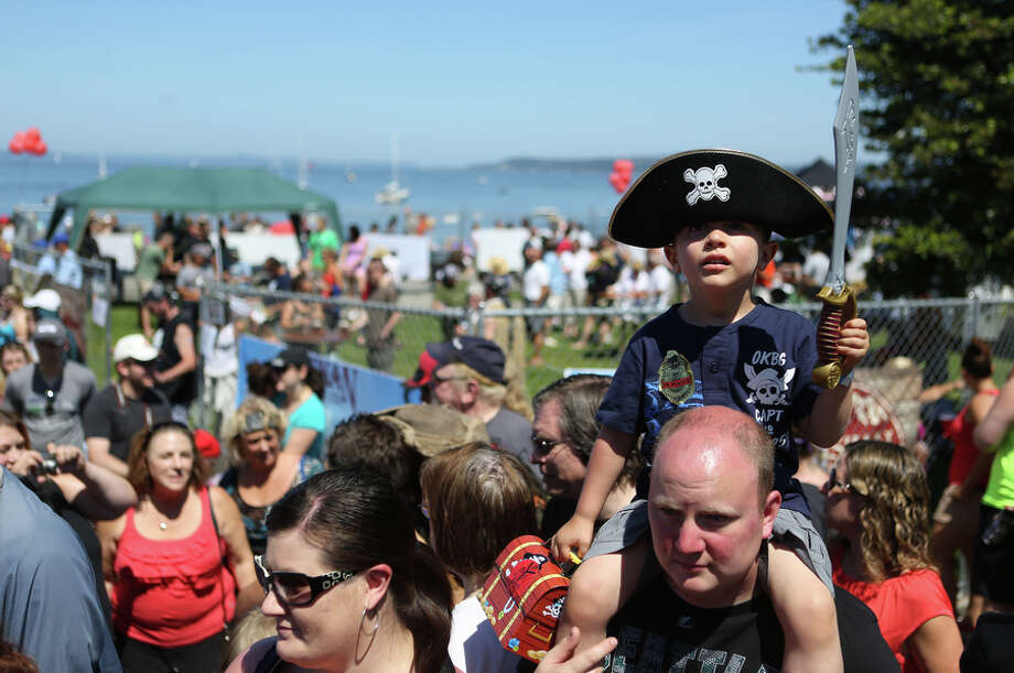 Jayden Pereira, 3, watches the action during the Seafair Pirates Landing. Photo: JOSHUA TRUJILLO, SEATTLEPI.COM