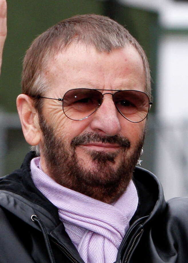 FILE - This Jan. 11, 2008 file photo shows former Beatles member Ringo Starr in Liverpool, England. New York City's Metropolitan Museum of Art will display Ringo Starr's gold-plated snare drum in a special exhibition honoring the ex-Beatle's 70th birthday. The museum said Tuesday, June 29, 2010, the drum will be shown from July 7, Starr's birthday, through December.  (AP Photo/Jon Super, File) Photo: Jon Super / AP