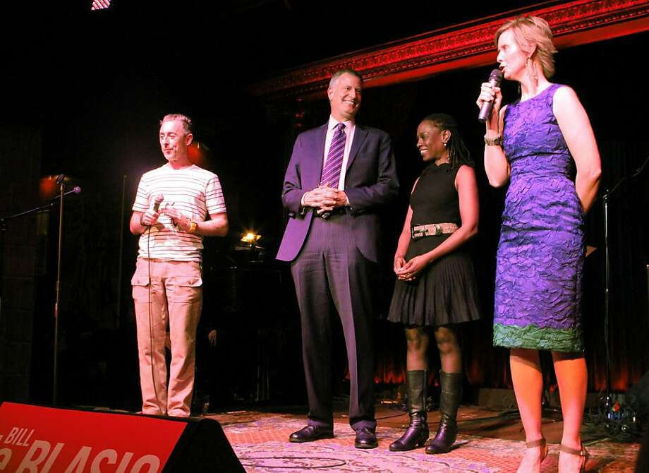"Tony Award-winning actor Alan Cumming (left) and Cynthia Nixon (right) of ""Sex and the City"" fame join mayoral candidate Bill de Blasio and his wife, Chirlane McCray, at a campaign event. Photo: Uncredited, Associated Press"