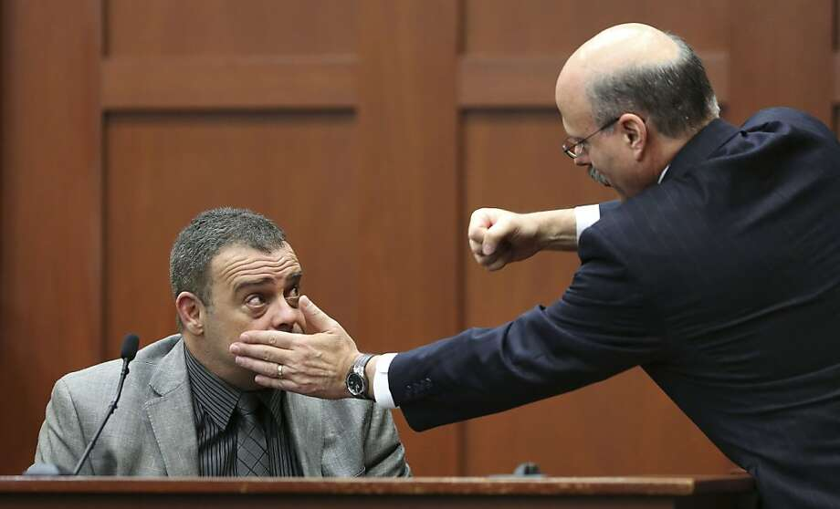Prosecutor Bernie de la Rionda (right) demonstrates a possible scenario as he questions Sanford police investigator Chris Serino, one of the state's witnesses, Tuesday at the George Zimmerman trial. Photo: Joe Burbank, Associated Press