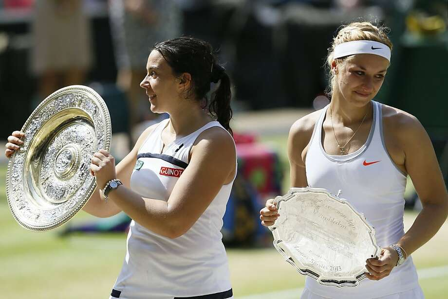 France's Marion Bartoli (left) beat Germany's Sabine Lisicki 6-1, 6-4 to become the first woman in the Open era to win Wimbledon without facing anyone seeded in the top 10. Photo: Kirsty Wigglesworth, Associated Press