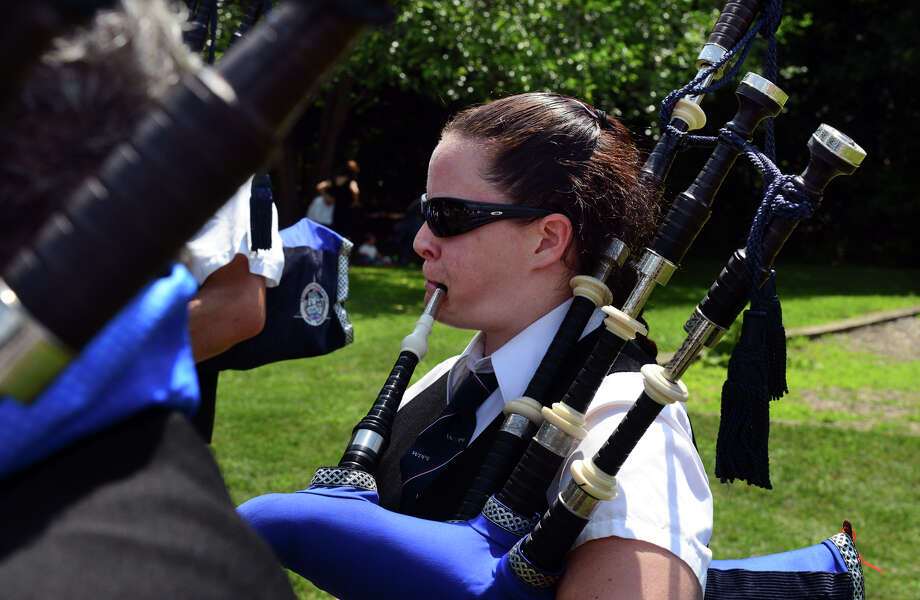 Suzy Lunnie, with the Westchester & District Pipe Band rehearses, during the 90th Annual Round Hill Highlander Games at Cranbury Park in Norwalk, Conn. on Saturday July 6, 2013. Photo: Christian Abraham / Connecticut Post