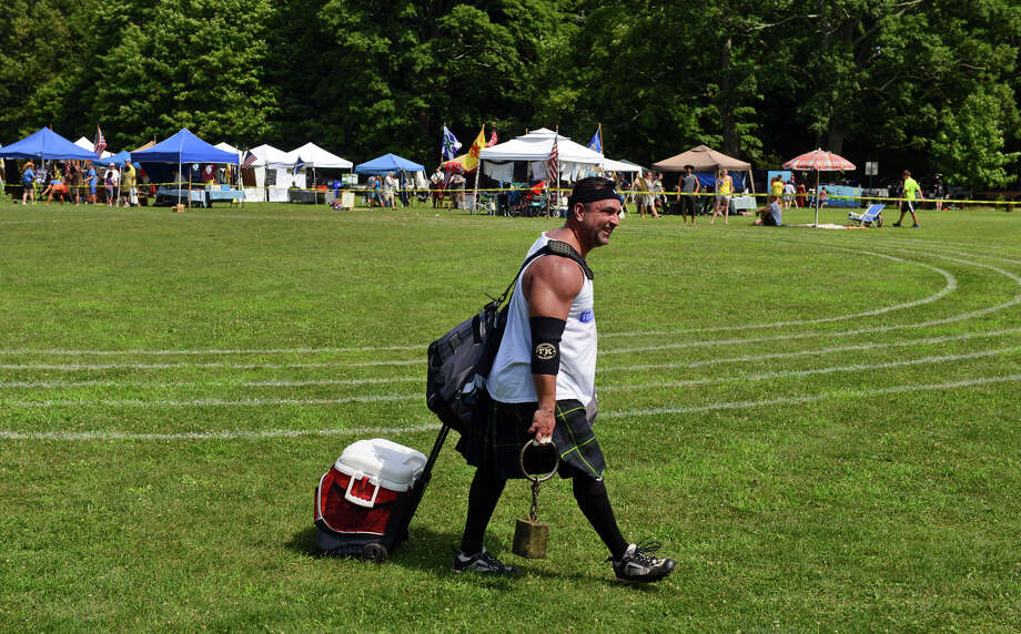 Steve Abramowitz, of Commack, Long Island, makes his way over to the next athletic event, during the 90th Annual Round Hill Highlander Games at Cranbury Park in Norwalk, Conn. on Saturday July 6, 2013. Photo: Christian Abraham / Connecticut Post