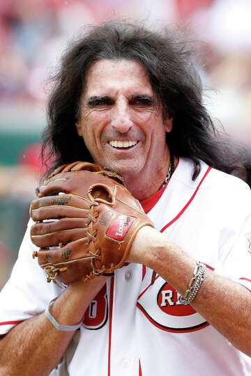 Rock musician Alice Cooper gets ready to throw out the first pitch before the interleague game betwe