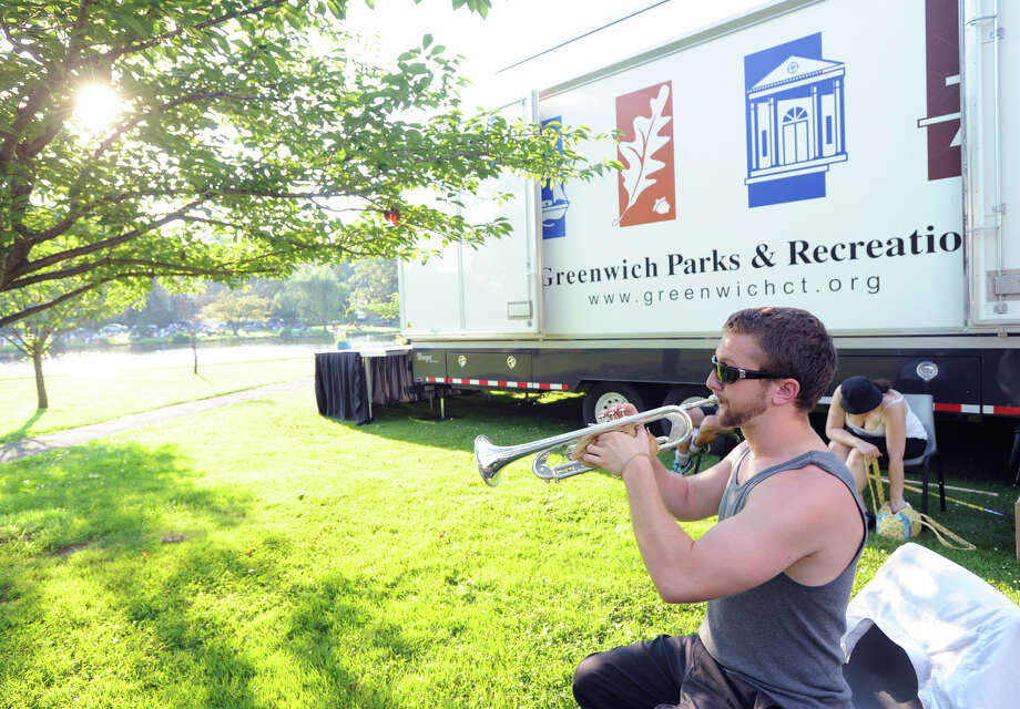 Ron Harter warms up on his trumpet prior to playing in the Sound Beach Community Band prior to the Town of Greenwich fireworks show at Binney Park in Old Greenwich, Saturday, July 6, 2013. Photo: Bob Luckey / Greenwich Time