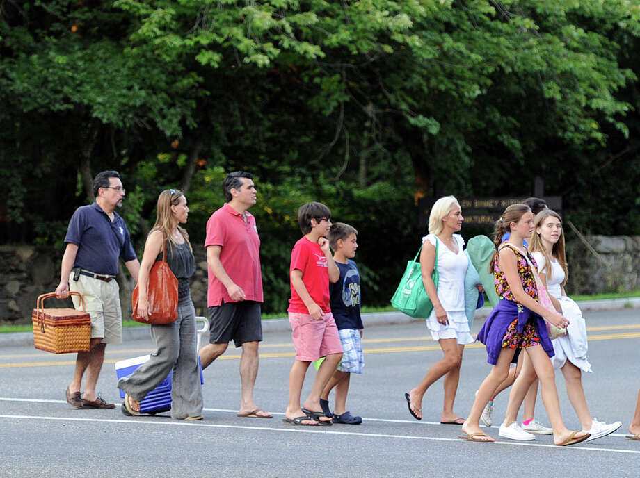 People walk toward Binney Park prior to the Town of Greenwich fireworks show at Binney Park in Old Greenwich, Saturday, July 6, 2013. Photo: Bob Luckey / Greenwich Time