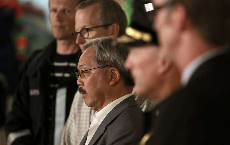 San Francisco Mayor Ed Lee,  (center) listens as Fire Chief Joanne Hayes-White releases details during a press conference in San Francisco, Calif., on Saturday July 6, 2013,  about the crash of Asiana Airlines flight 214 this morning at San Francisco International airport. Photo: Michael Macor, The Chronicle