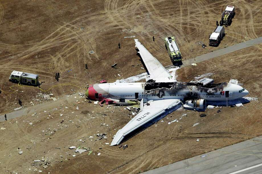 This aerial photo shows the wreckage of the Asiana Flight 214 airplane after it crashed at the San Francisco International Airport in San Francisco, Saturday,  July 6, 2013. (AP Photo/Marcio Jose Sanchez) ORG XMIT: CAMS105 Photo: Marcio Jose Sanchez / AP