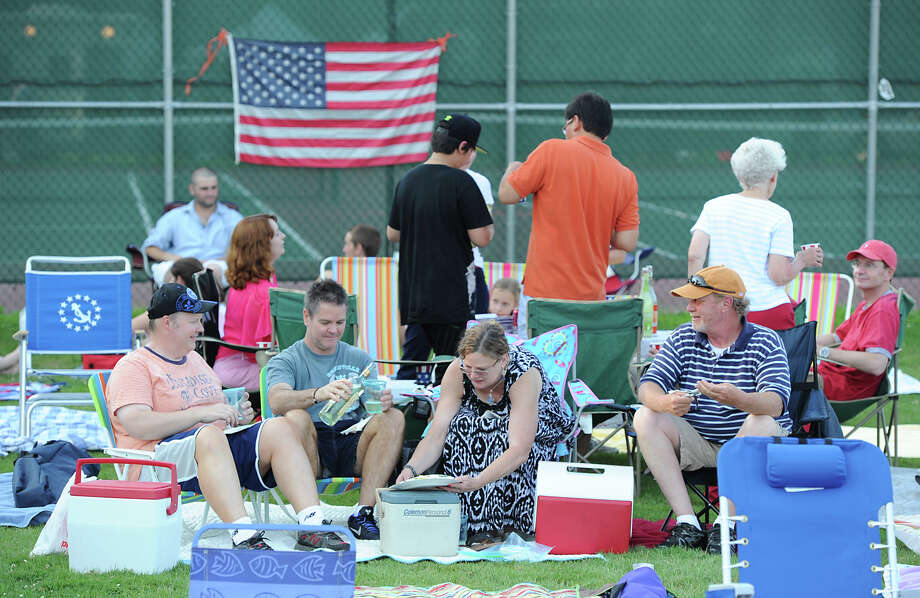 People gathered prior to the Town of Greenwich fireworks show at Binney Park in Old Greenwich, Saturday, July 6, 2013. Photo: Bob Luckey / Greenwich Time