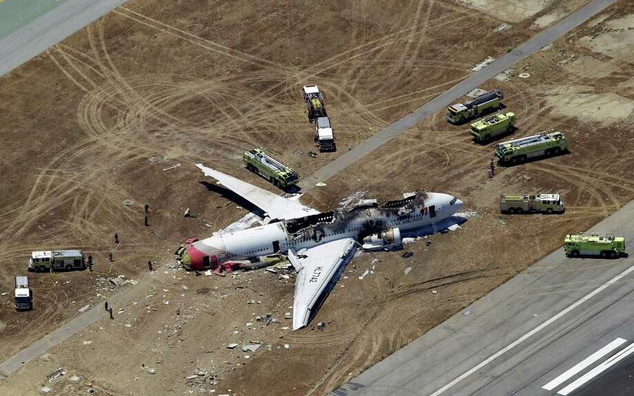 This aerial photo shows the wreckage of the Asiana Flight 214 airplane after it crashed at the San Francisco International Airport in San Francisco, Saturday,  July 6, 2013. (AP Photo/Marcio Jose Sanchez) Photo: Marcio Jose Sanchez, STF / AP
