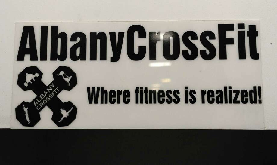 A sign hangs on the wall at Albany CrossFit which is located in The Court Club on Thursday, June 27, 2013 in Colonie, N.Y. (Lori Van Buren / Times Union) Photo: Lori Van Buren / 00022993A