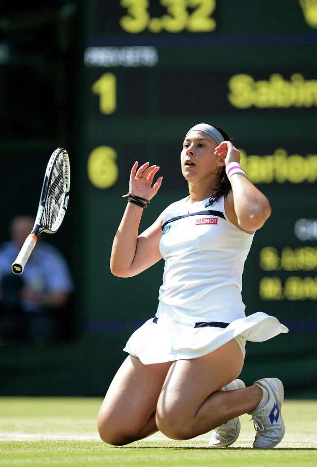 LONDON, ENGLAND - JULY 06:  Marion Bartoli of France celebrates championship point during the Ladies' Singles final match against Sabine Lisicki of Germany on day twelve of the Wimbledon Lawn Tennis Championships at the All England Lawn Tennis and Croquet Club on July 6, 2013 in London, England.  (Photo by Dennis Grombkowski/Getty Images) *** BESTPIX *** ORG XMIT: 146049558 Photo: Dennis Grombkowski / 2013 Getty Images