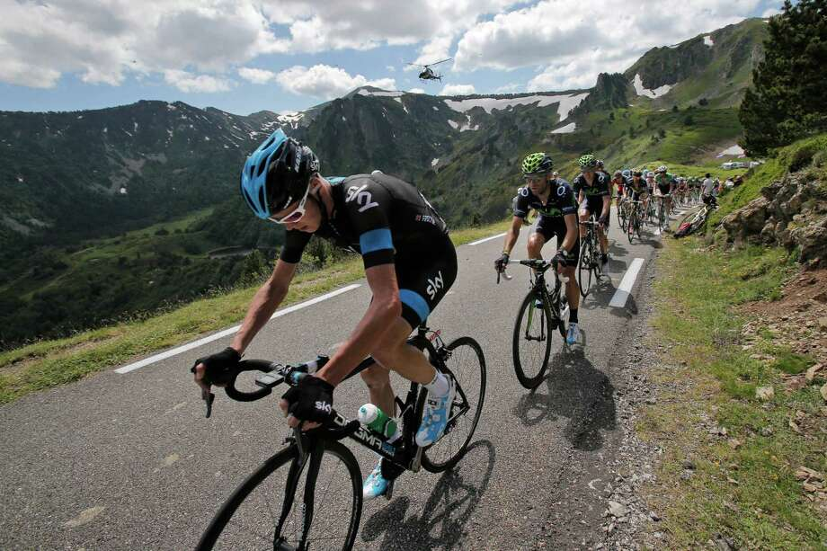 New overall leader Christopher Froome of Britain, left, climbs Pailheres pass followed by Spain's Alejandro Valverde during the eight stage of the Tour de France cycling race over 195 kilometers (122 miles) with start in Castres and finish in Ax 3 Domaines, Pyrenees region, France, Saturday July 6 2013. (AP Photo/Christophe Ena) ORG XMIT: PDJ118 Photo: Christophe Ena / AP