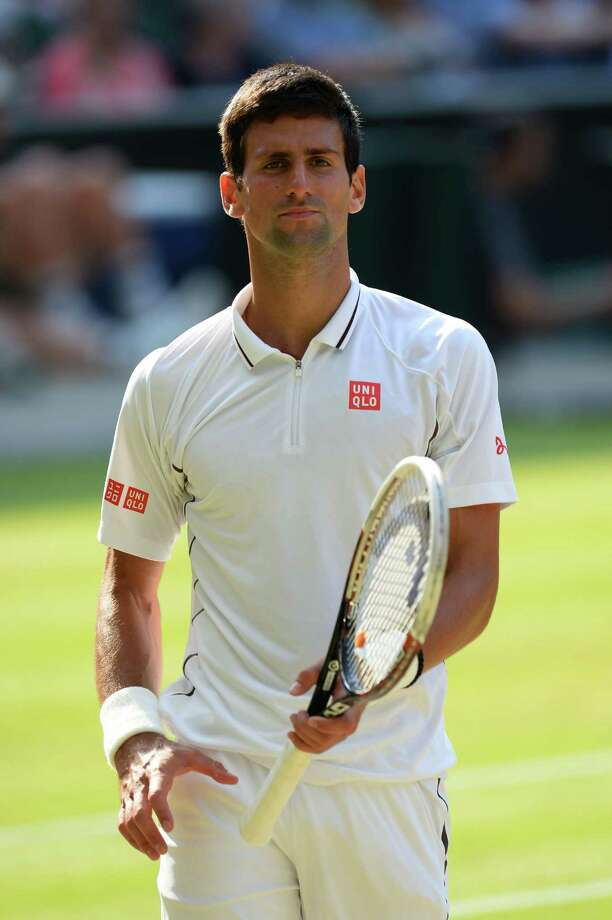 LONDON, ENGLAND - JULY 05:  Novak Djokovic of Serbia looks on during the Gentlemen's Singles semi-final match against Juan Martin Del Potro of Argentina on day eleven of the Wimbledon Lawn Tennis Championships at the All England Lawn Tennis and Croquet Club on July 5, 2013 in London, England.  (Photo by Mike Hewitt/Getty Images) ORG XMIT: 168810739 Photo: Mike Hewitt / 2013 Getty Images