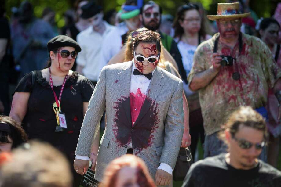 An undead Psy wanders during the fifth annual Red, White and Dead Zombie Walk Saturday, July 6, 2013, around the Seattle Center in Seattle. This year, the horde relocated from their long-time Fremont location to the larger Seattle Center to accommodate more roaming, undead bodies. Photo: JORDAN STEAD, SEATTLEPI.COM / SEATTLEPI.COM