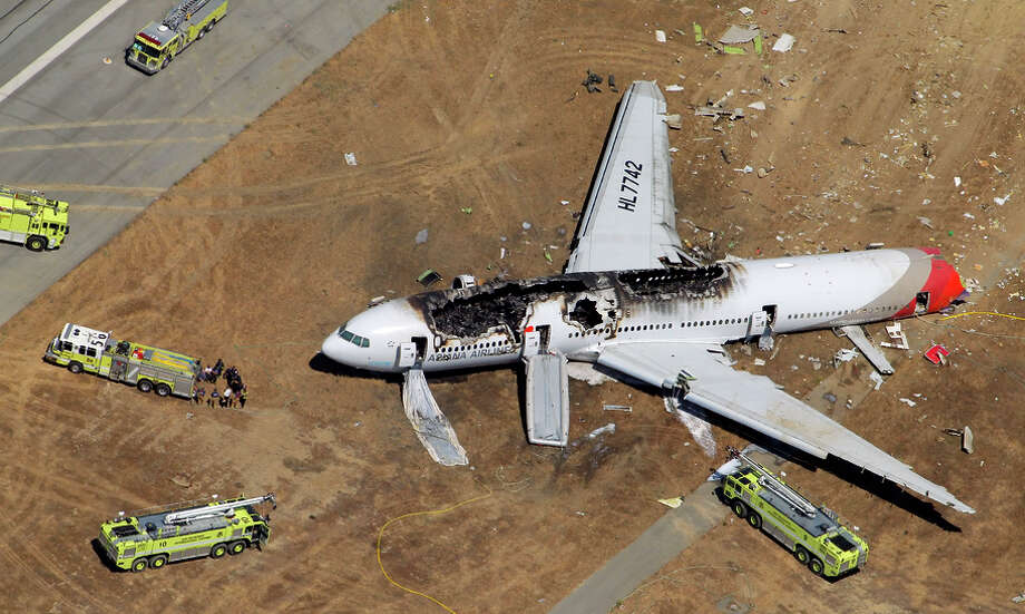 The destroyed fuselage of Asiana Airlines Flight 214 is visible on the runway at San Francisco International Airport after it crashed on landing and burned on Saturday, July 6, 2013. Photo: Carlos Avila Gonzalez / The Chronicle / ONLINE_YES